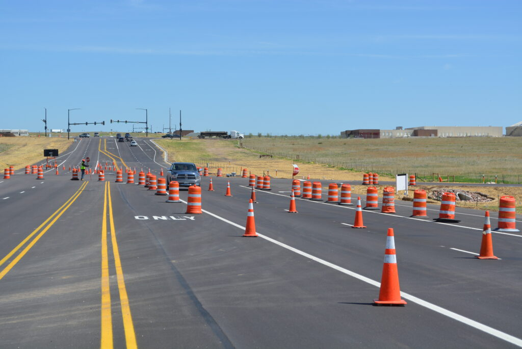 Department of Public Works employees working on a road in El Paso County