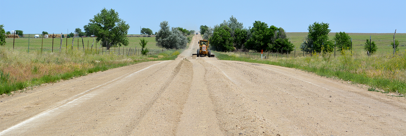 Grader on County road